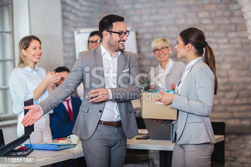 924520144 istock photo Smiling team leader executive introducing new just hired female employee to colleagues. 1158551661