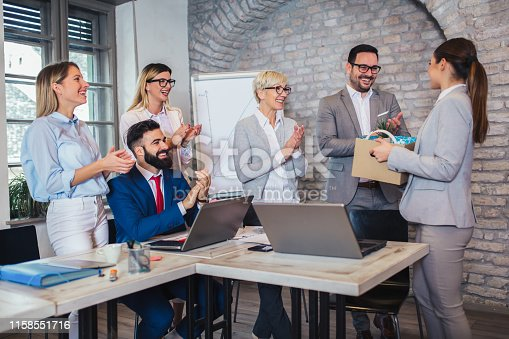 924520144 istock photo Smiling team leader executive introducing new just hired female employee to colleagues. 1158551716