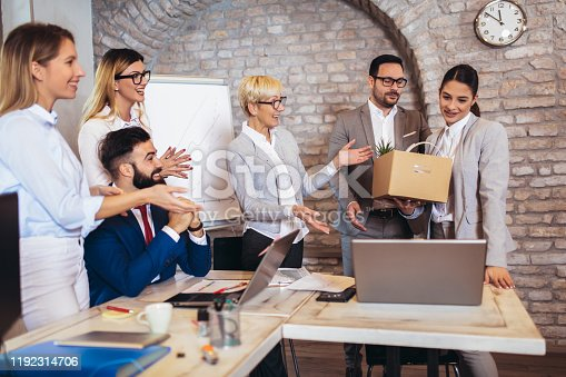 924520144 istock photo Smiling team leader executive introducing new just hired female employee to colleagues. 1192314706
