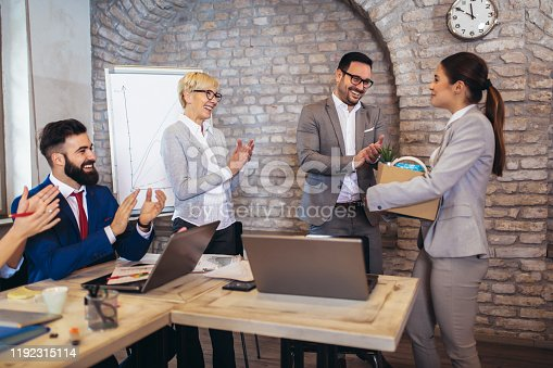 924520144 istock photo Smiling team leader executive introducing new just hired female employee to colleagues. 1192315114