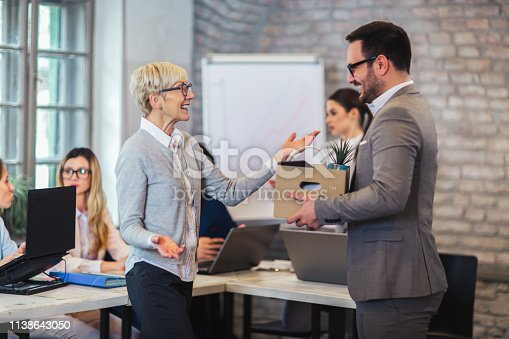 istock Smiling team leader executive introducing new just hired male employee to colleagues. 1138643050