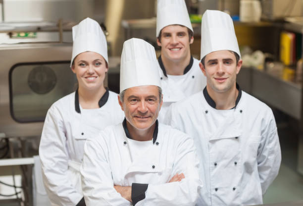 Smiling team of Chefs stock photo