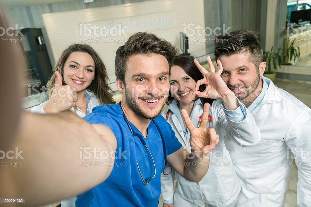 Smiling Team Of Doctors And Nurses At Hospital Taking Selfie royaltyfri bildbanksbilder
