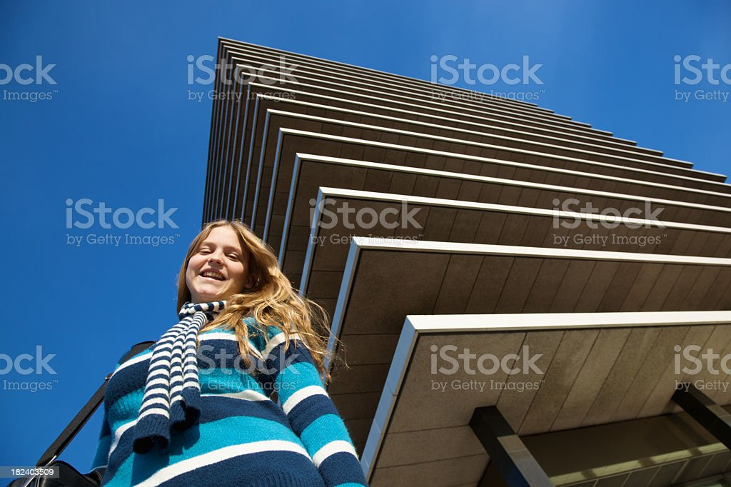 Smiling Teen Girl Outside a Building royalty-free stock photo