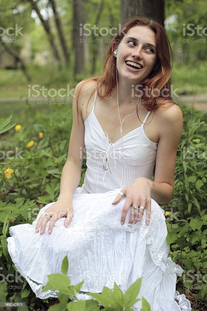 Smiling teen in headphones royalty-free stock photo