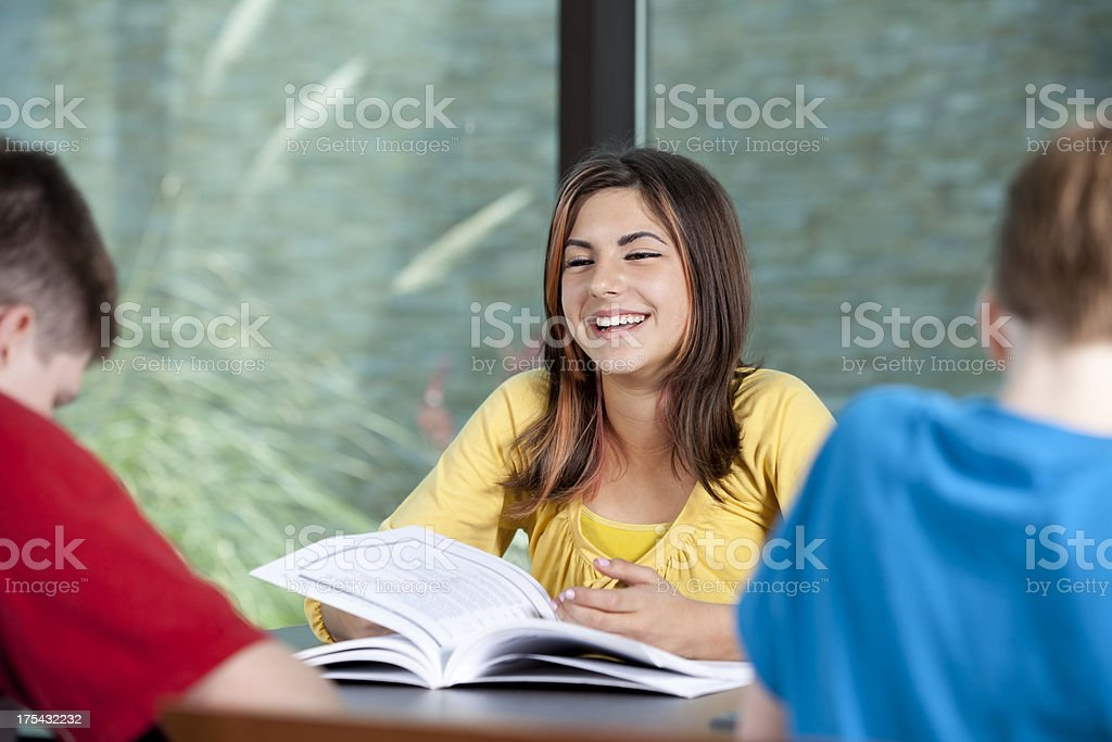 Smiling Teen Studying royalty-free stock photo