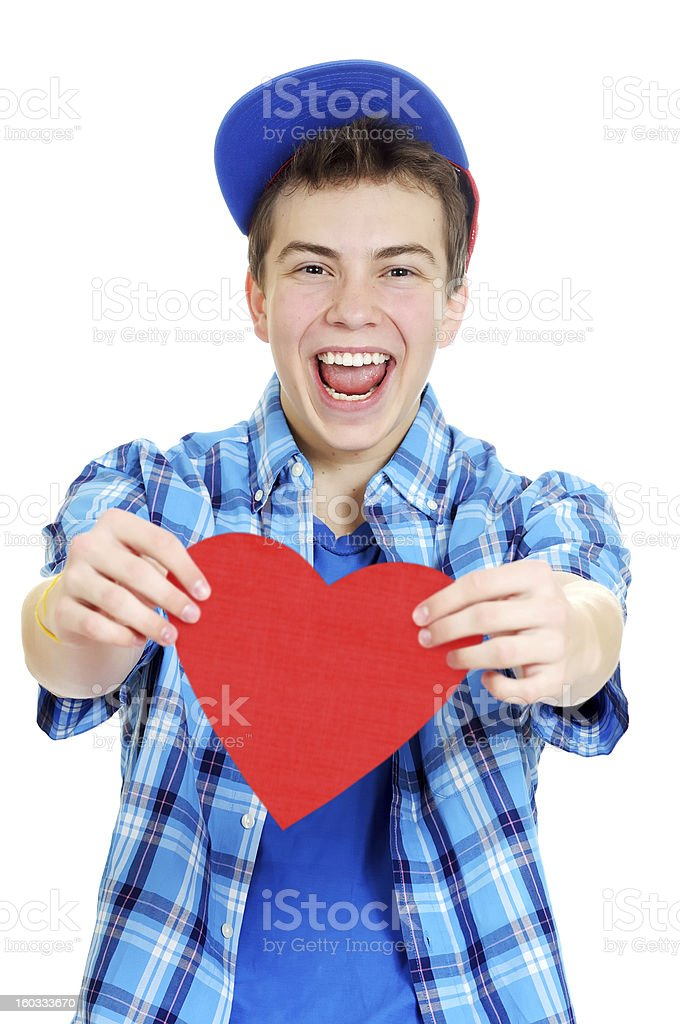Smiling teenage boy holding valentine heart royalty-free stock photo