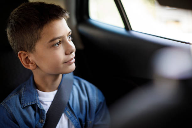 smiling teenage boy in the car - boy looking out window stock pictures, royalty-free photos & images