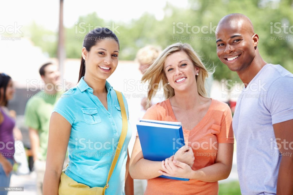 Smiling teenage classmates standing together royalty-free stock photo