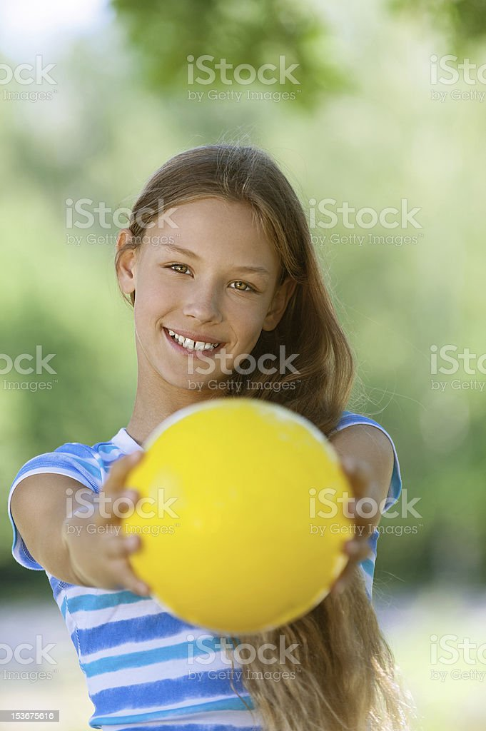 smiling teenage girl holding yellow ball royalty-free stock photo