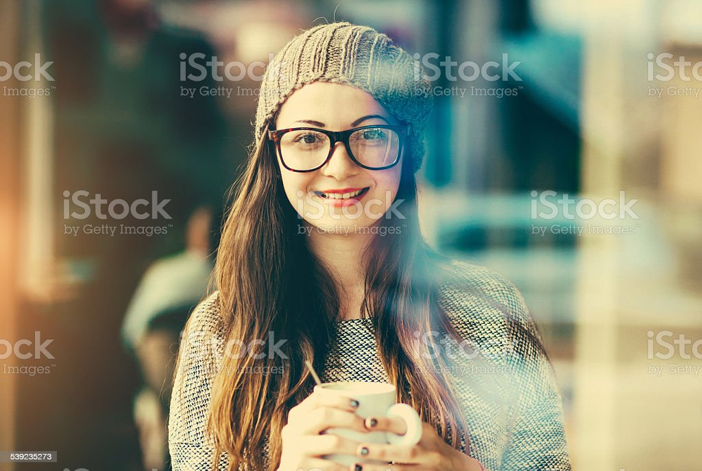 Smiling teenage girl with coffee cup portrait royalty-free stock photo