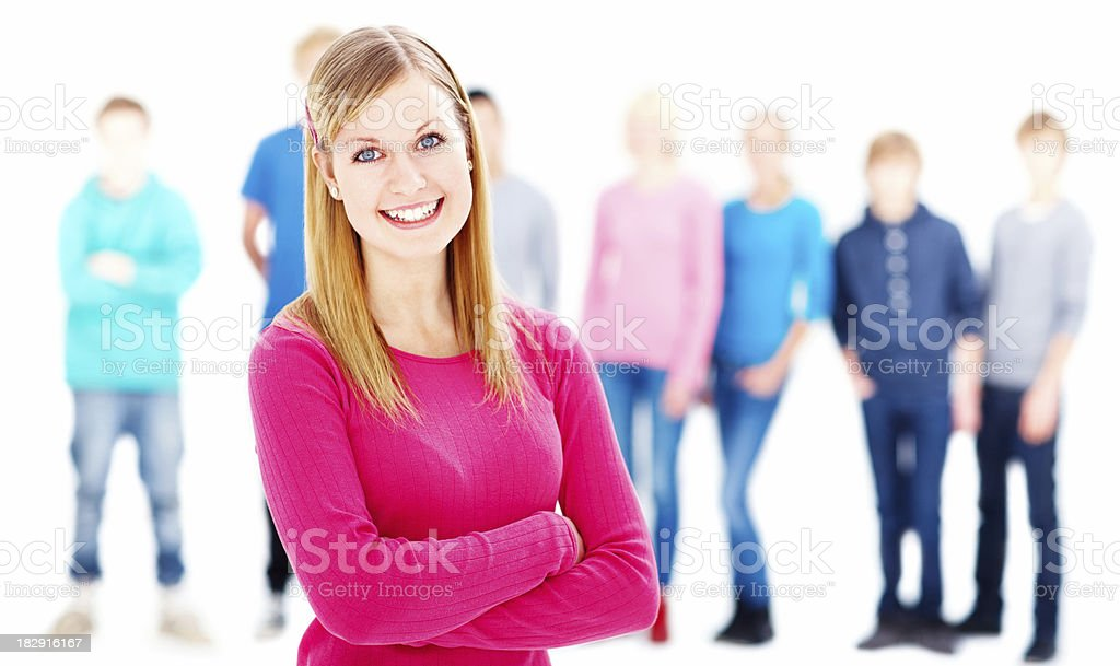 Smiling teenage girl with friends in the background royalty-free stock photo