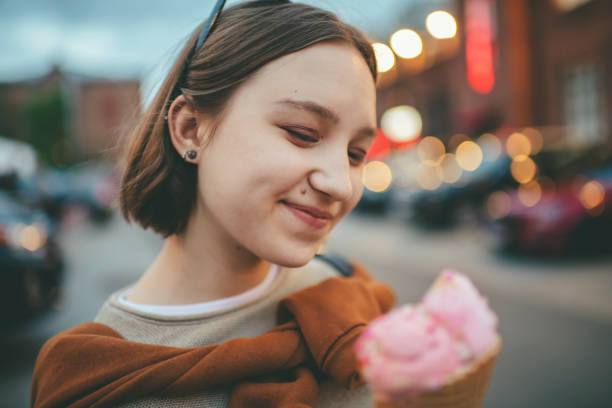 smiling teenage girl with pink melting ice-cream outdoors in summer - nails ice cream imagens e fotografias de stock