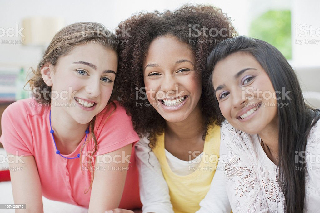Smiling teenage girls stock photo