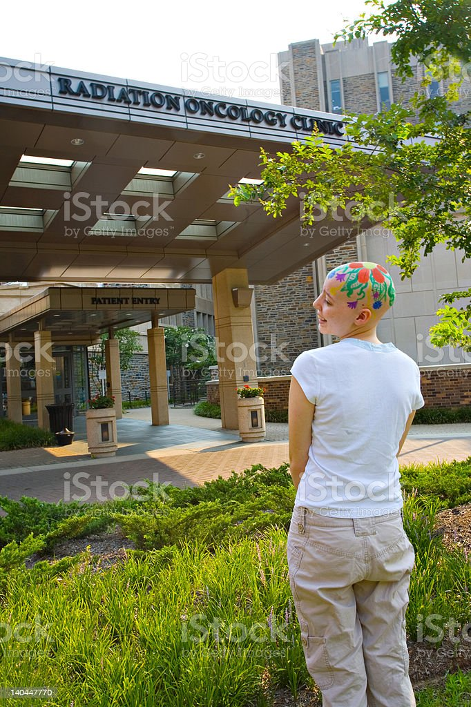 smiling teenage oncology patient stock photo