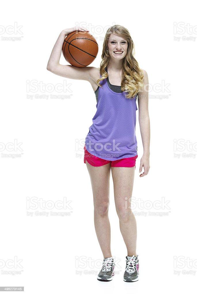 Smiling teenager  holding basketball royalty-free stock photo