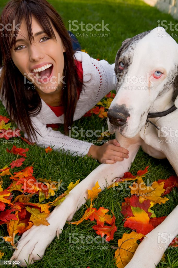 Girl laying with a greatdane