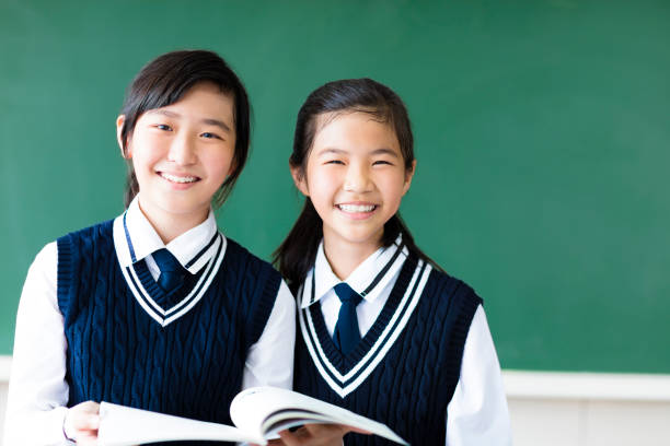 smiling  teenager student girls in  classroom smiling  teenager student girls in  classroom japanese school girl stock pictures, royalty-free photos & images