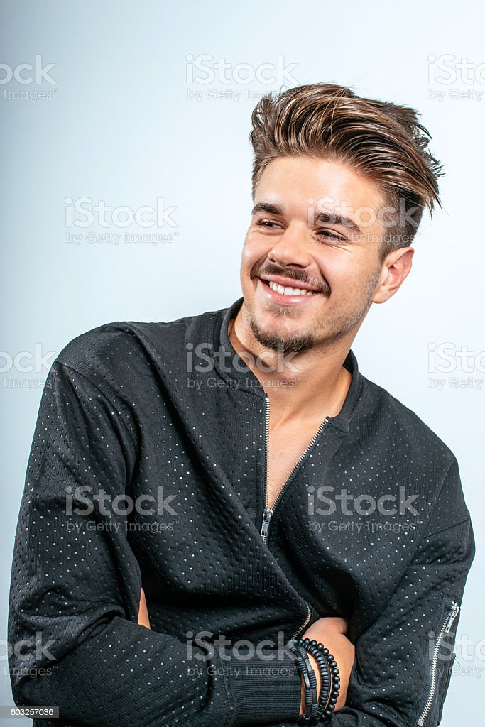 Smiling Teenager With Modern Undercut Hairstyle Stock Photo More