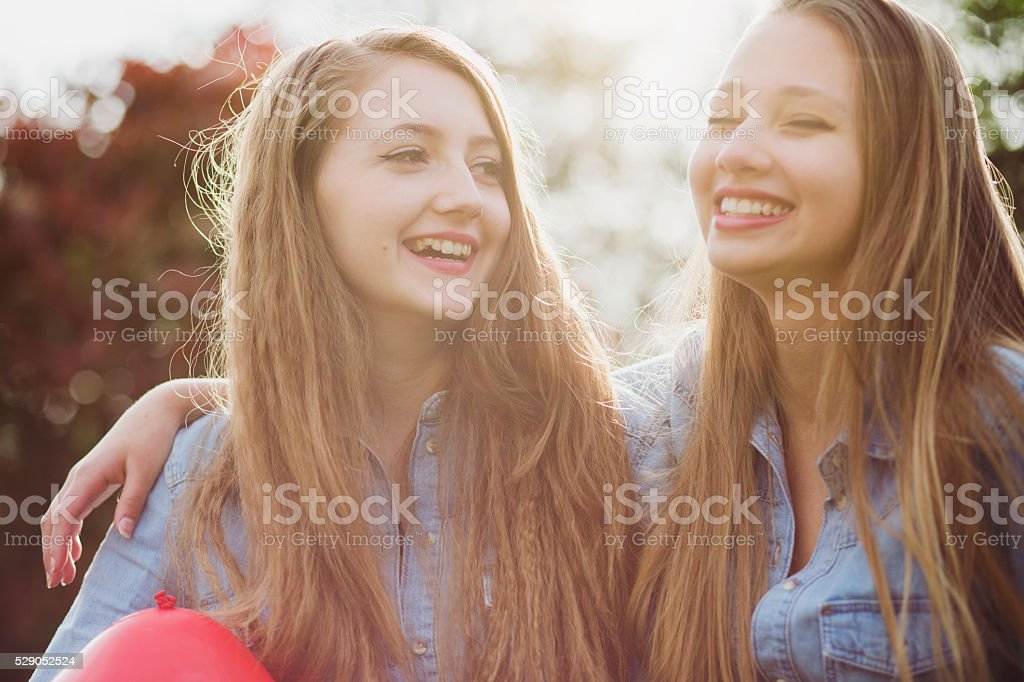 Smiling teenagers with red ballon. stock photo