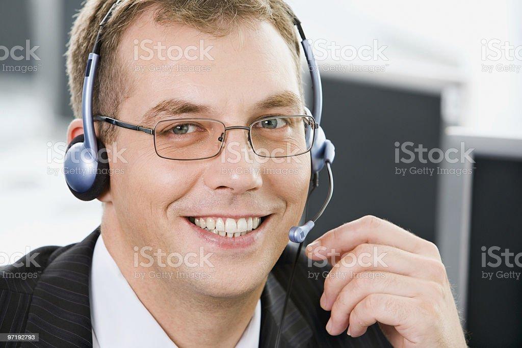 Smiling telephone operator royalty-free stock photo