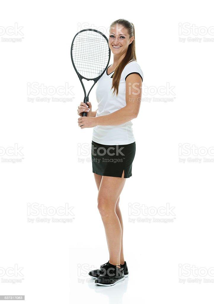 Smiling tennis player looking at camera stock photo