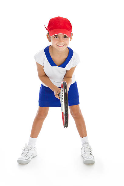 Smiling tennis player with racket in position stock photo