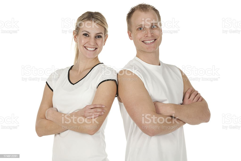 Smiling tennis players posing royalty-free stock photo