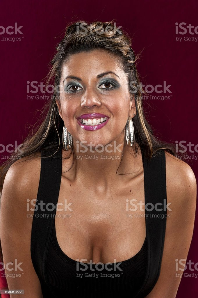 Smiling thirty something spanish woman stock photo