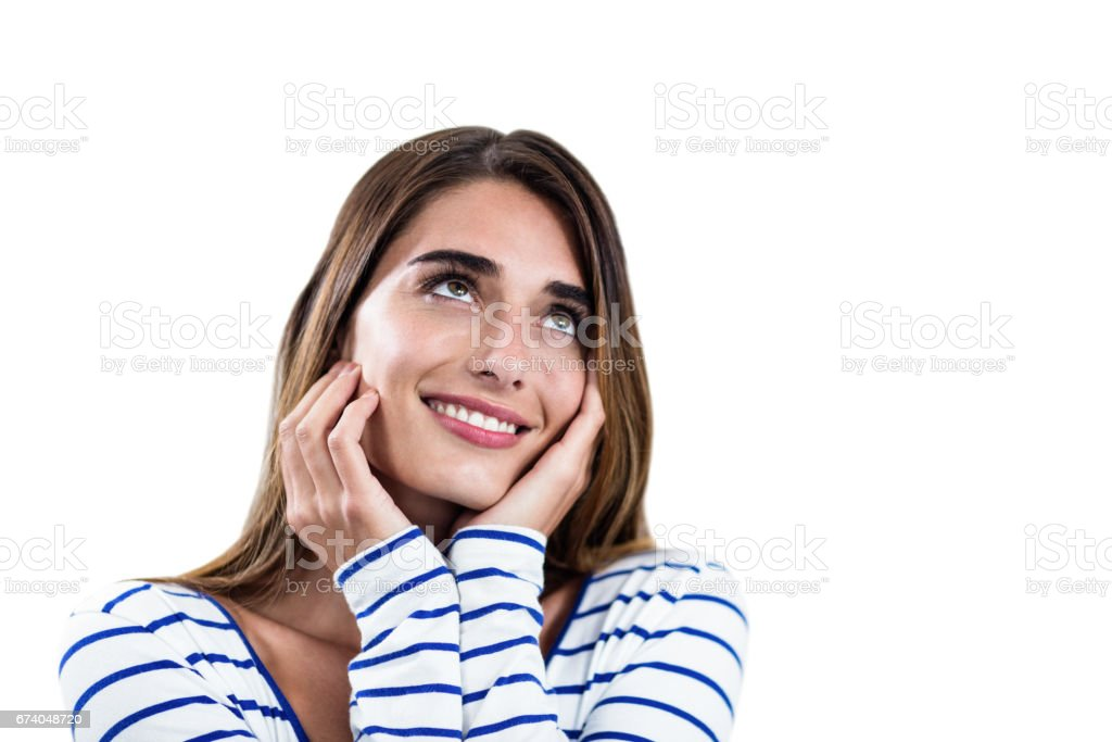 Smiling thoughtful young woman royalty-free stock photo