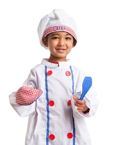 Smiling Toddler dressed as a Chef, isolated on white stock photo