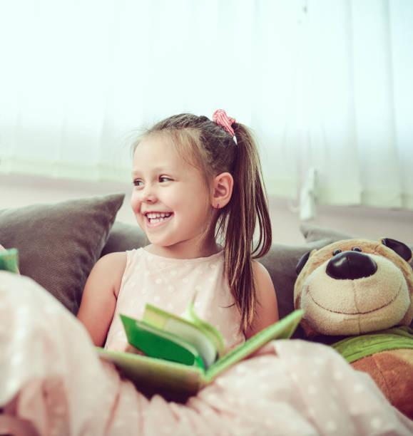 Smiling toddler girl reading book to toy bear picture id854818272?b=1&k=6&m=854818272&s=612x612&w=0&h=x1j5ukffadhquznlgtolynx rjdbofxjnsod hsdmhm=