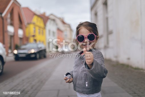 istock Smiling toddler holding a thumbs up 1001680224