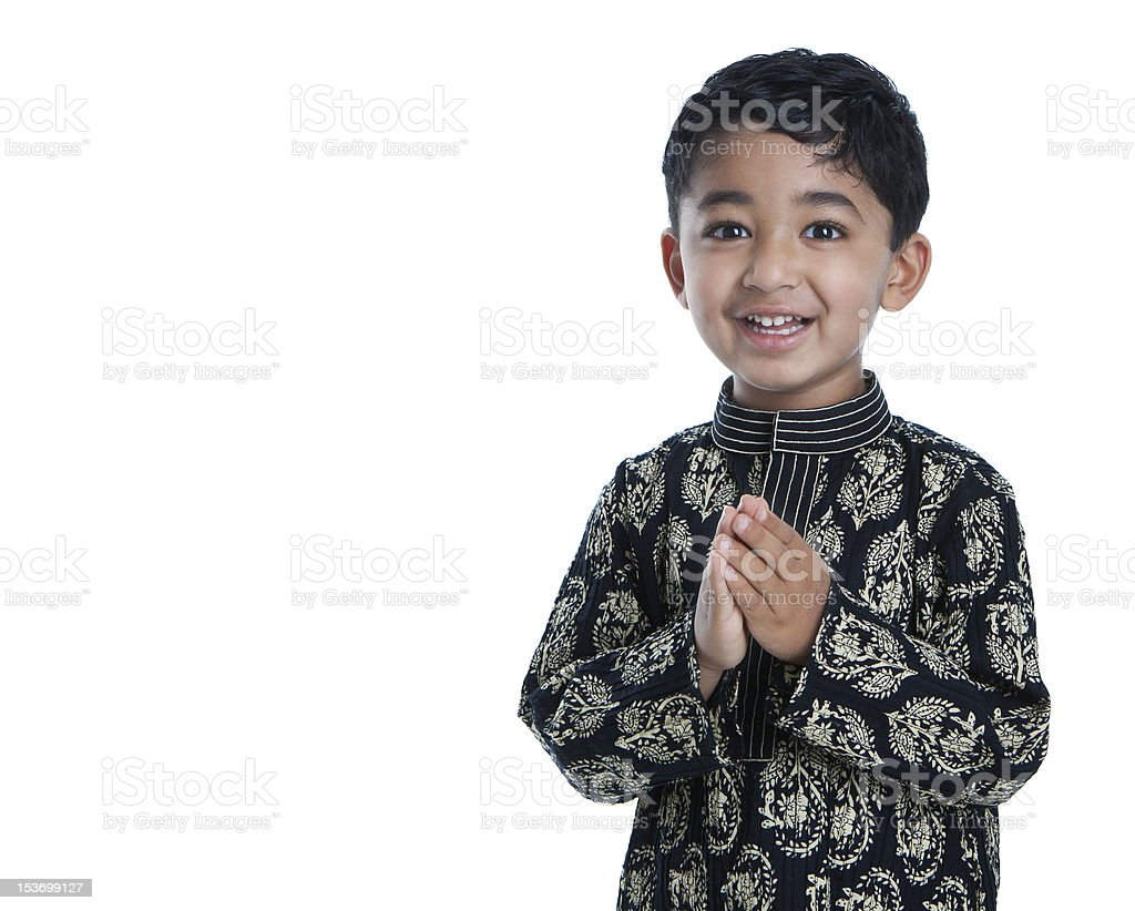 Smiling Toddler with Folded Hands Signifying Traditional Greeting, Namaste stock photo