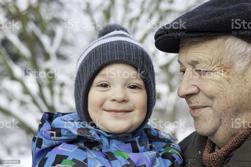 Smiling toddler with grandfather royalty-free stock photo