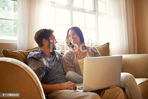 istock Smiling together over social media 511389345