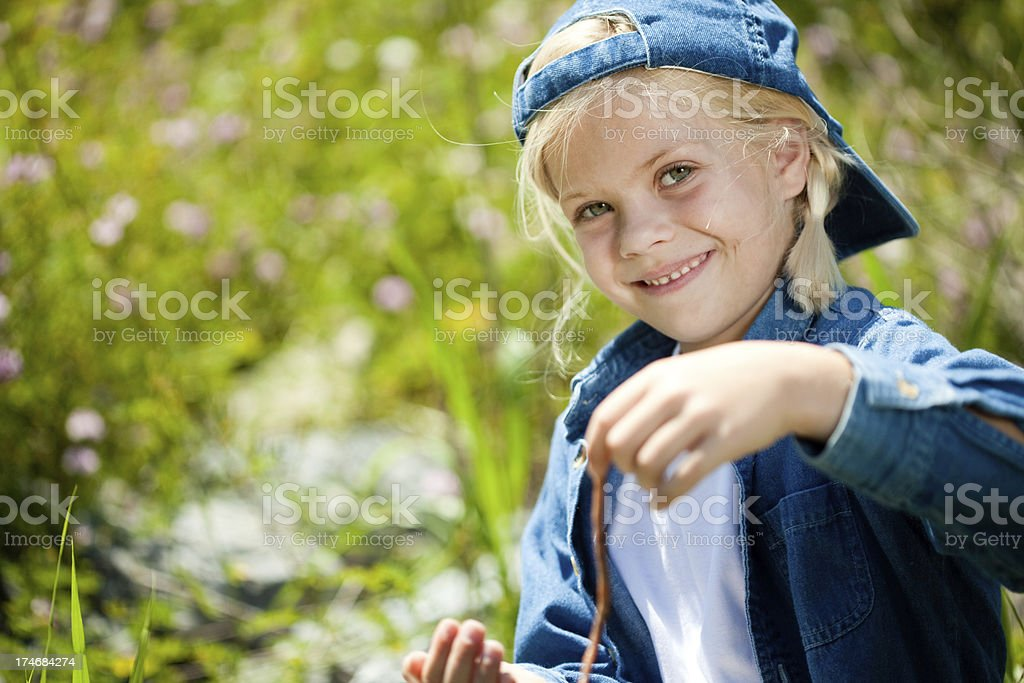Smiling Tomboy with a worm stock photo