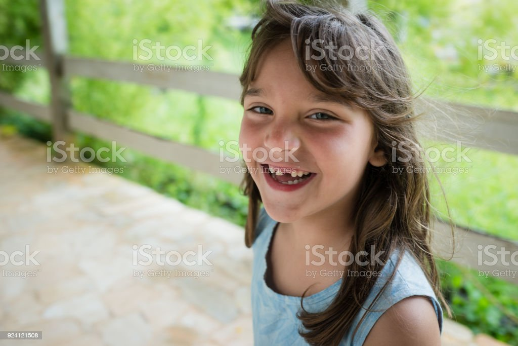 Smiling toothless little girl stock photo