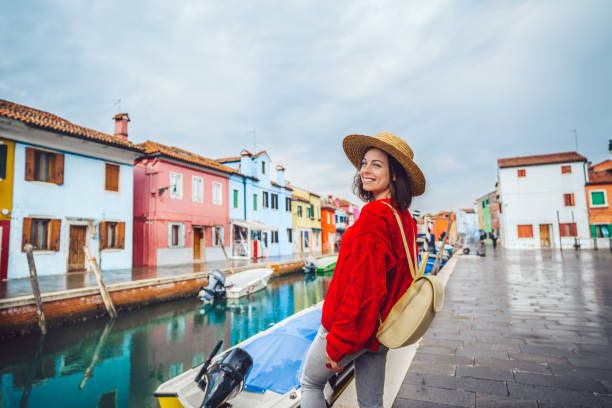 Smiling tourist traveling in Italy stock photo