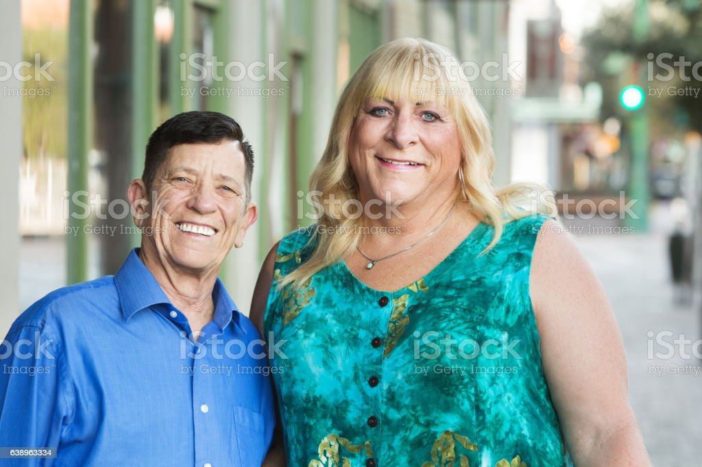 Smiling transgender male and female friends stock photo