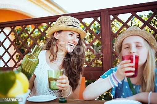 istock smiling trendy family sitting at table having brunch 1298255706