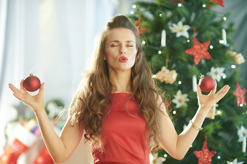 Smiling Trendy Woman Near Christmas Tree Doing Yoga Stock Photo - Download Image Now