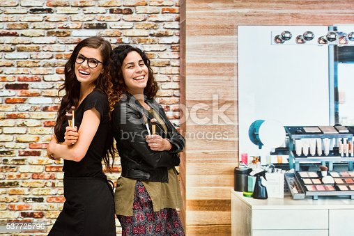 620404536istockphoto Smiling two make-up artist standing indoors 537725796