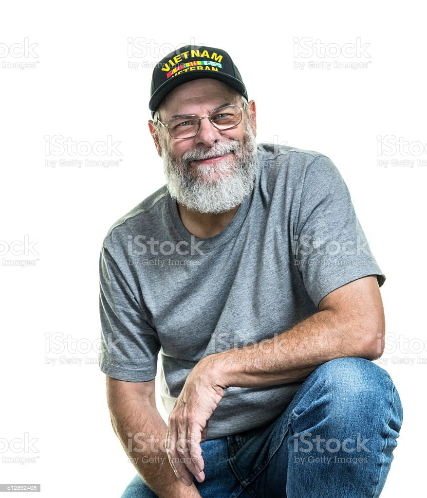 Smiling USA Vietnam War Military Veteran Leaning On One Knee stock photo