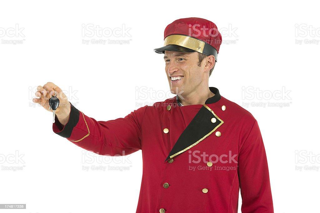 Smiling valet holding a key stock photo