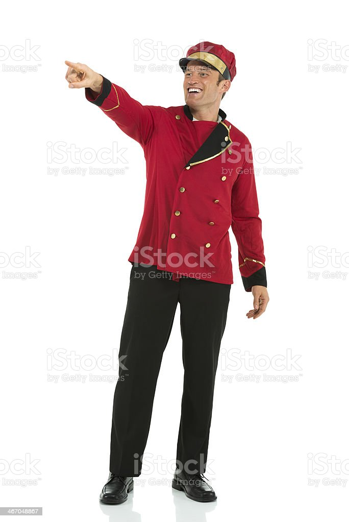 Smiling valet pointing royalty-free stock photo