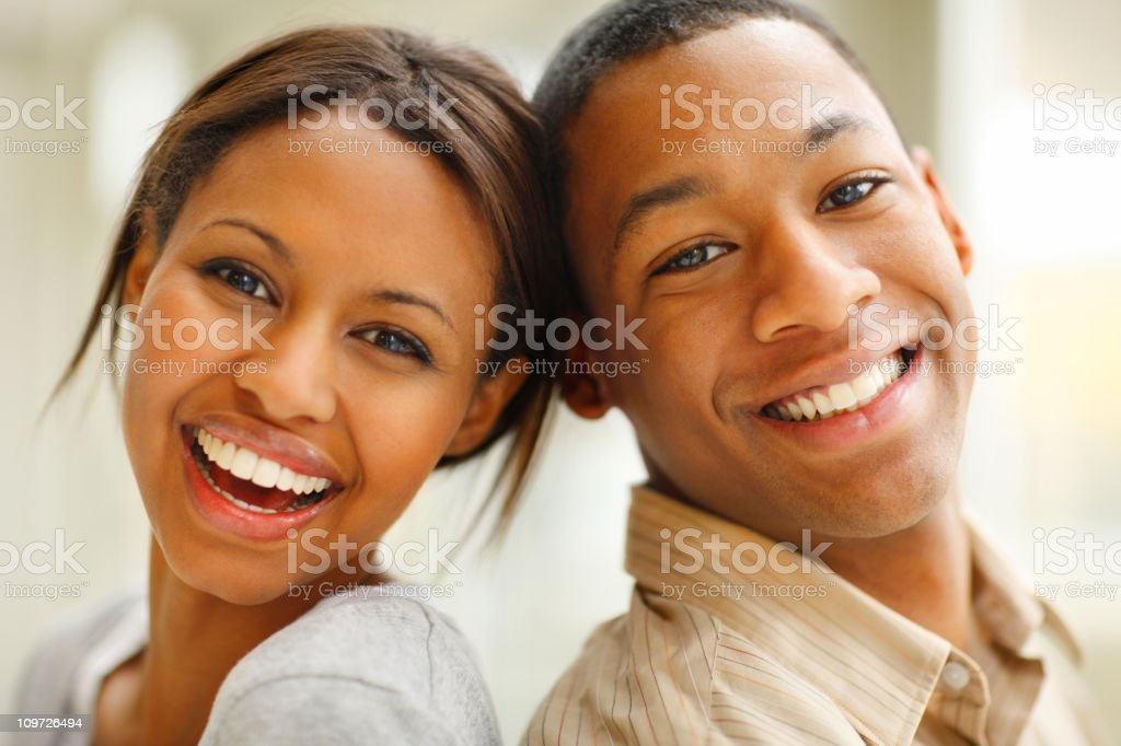 Smiling, vibrant, happy young couple royalty-free stock photo