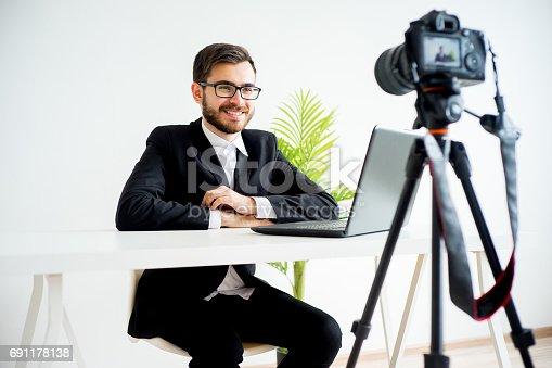 istock Smiling video blogger 691178138