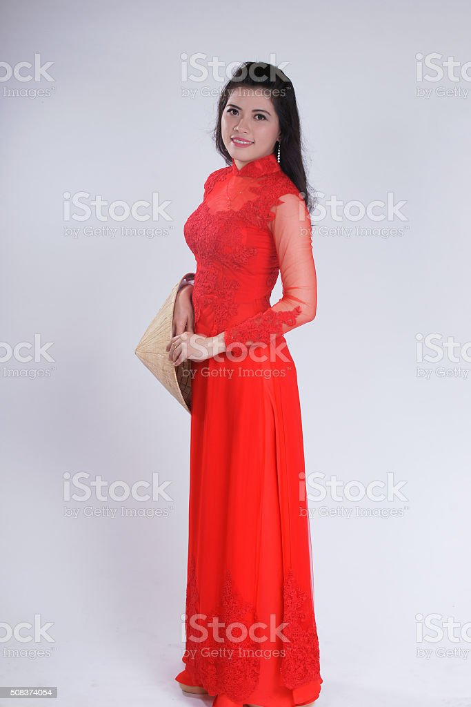Smiling Vietnamese female with ao dai, vietnam traditional dress stock photo