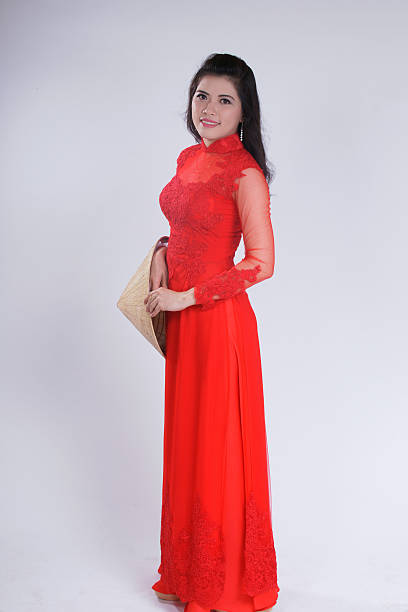 smiling vietnamese female with ao dai, vietnam traditional dress - ao dai stock photos and pictures